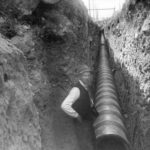 man standing in sewer trench, Vancouver, 1911