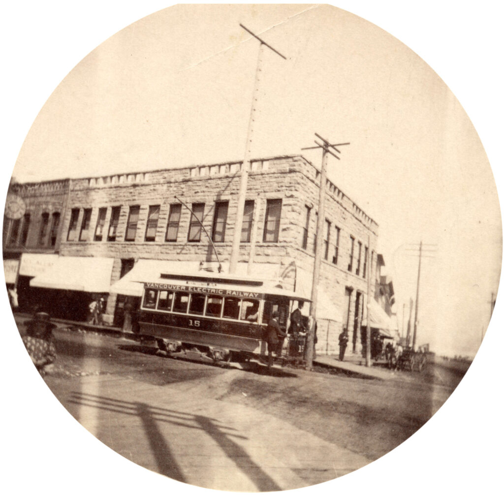 early Vancouver streetcar turning the corner at Carrall and Cordova streets