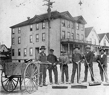 Scavengers with brooms and hand-cart